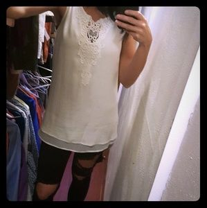 Sleeveless long embroidered blouse